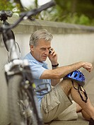 Man on mobile phone with bicycle