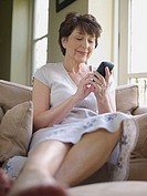 Mature woman using handheld computer