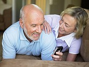 Mature couple with mobile phone