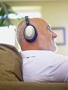 Mature man listening to headphones