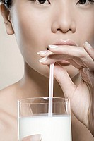 Woman drinking milk with straw