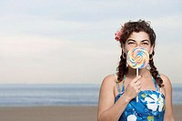 Woman on beach with lollipop