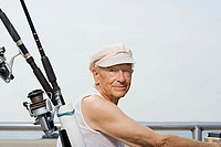 Senior man with fishing rod