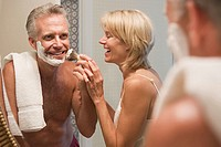Woman helping husband shave