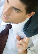 Businessman holding coat over shoulder