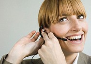 Woman smiling and putting on headset