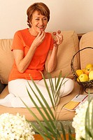 ELDERLY PERSON EATING FRUIT<BR>Model.