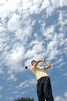 High angle view of a man playing a golf stroke