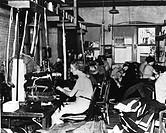 Women working in a garment sweat shop.