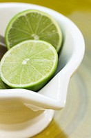 Ceramic bowl filled with fresh lime slices