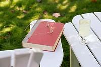 Still life with book, eyeglasses and lemonade