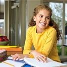 Preteen girl doing homework
