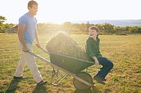 Father giving his son a ride in a wheelbarrow