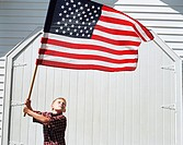 Boy waving the American flag (thumbnail)
