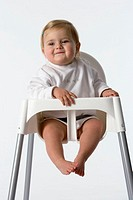Baby girl in baby-chair