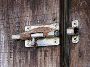 Rusted bolt on an old shed door