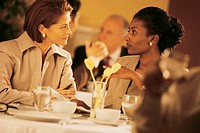 Businesswomen at restaurant.