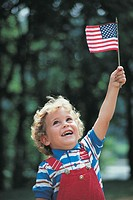 Little boy holding US flag.
