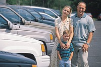 CAUCASIAN FAMILY AT A CAR DEALERSHIP
