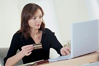 Woman paying bills online.