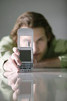 Man holding cell phone.