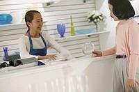 Sales clerk assisting customer.
