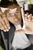 Businessman making hand gesture.