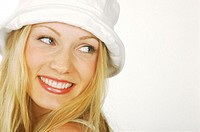 Portrait of a Young Woman With Blonde Hair Wearing a White Hat