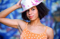 Portrait of a Young Woman With Long Curly Hair Wearing a Hat (thumbnail)