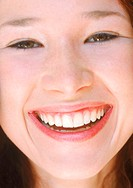 Close Up of a Young Woman Laughing