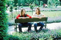 Two Women Sitting on Park Bench