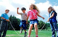 Young children skipping in the park (thumbnail)