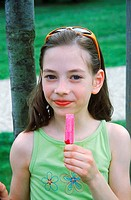 Young girl holding candy (thumbnail)