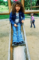 Young girl playing on a slide