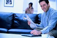 Man entering data in tablet PC, portrait.