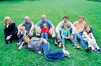 Portrait of a family sitting on a lawn
