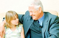 Portrait of a girl sitting with her grandfather