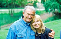 Portrait of mature couple standing in a lawn