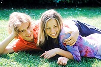 Young couple lying in the grass (thumbnail)