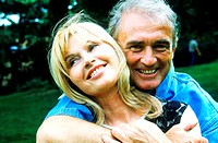 Portrait of a mature couple holding each other smiling (thumbnail)