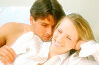 Young couple lying together (thumbnail)