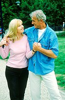 Mature couple holding each other smiling (thumbnail)
