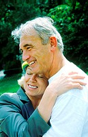 Portrait of a mature couple hugging and smiling (thumbnail)