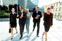 Group of business executives walking together outdoors