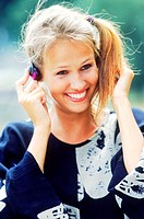 Young woman wearing headphones and smiling