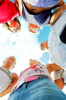 Low angle view of a group of young people standing in a circle