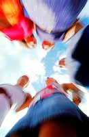 Low angle blurred view of a group of young people standing in a circle (thumbnail)