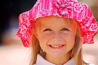 Close-up of a girl wearing hat and smiling