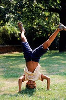 A boy doing the handstand