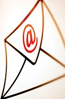 Close-up of 'at' symbol on an envelope
